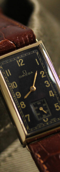 オメガのシックな黒色文字盤 品ある縦長アンティーク腕時計 【1940年製】-W1529-12
