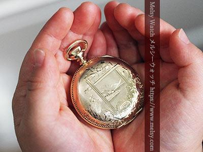子供の手と懐中時計