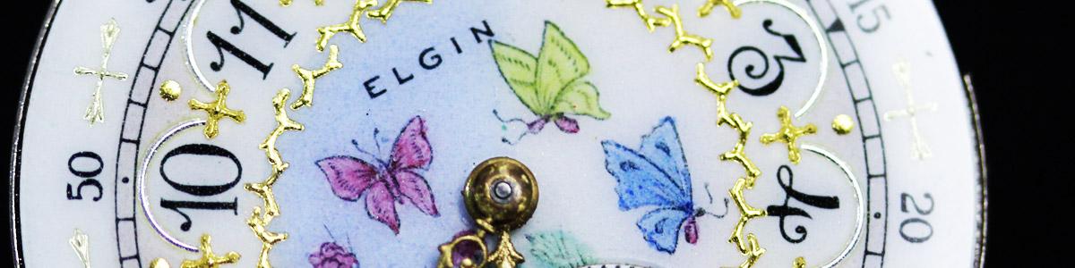 色とりどりの蝶が描かれた文字盤